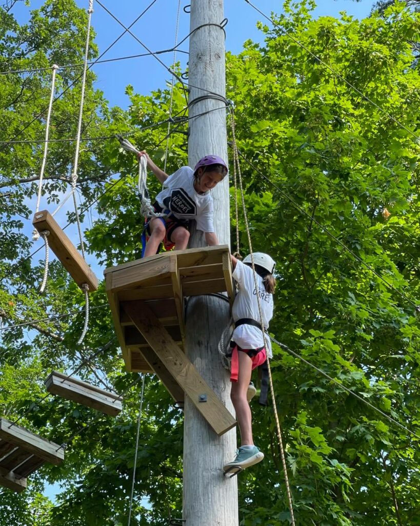 ropes course girls helping each other